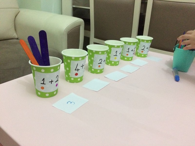 wooden stick and cups math activity