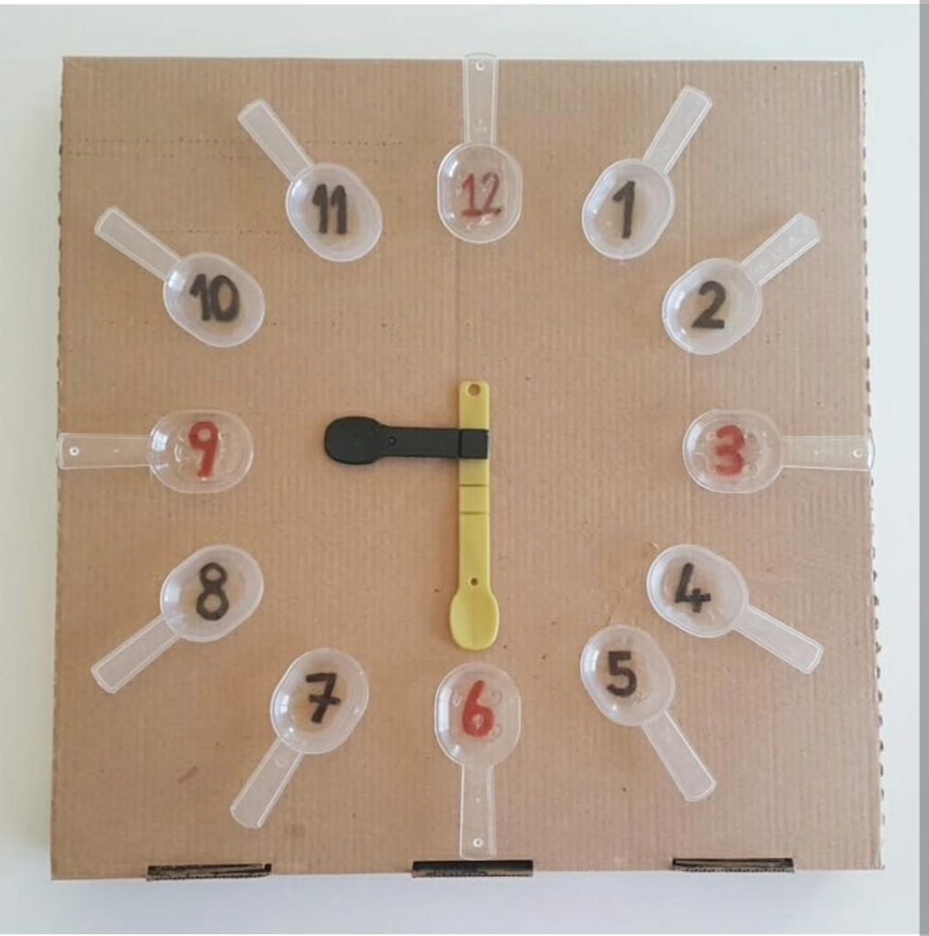 telling time activity with using plastic spoon